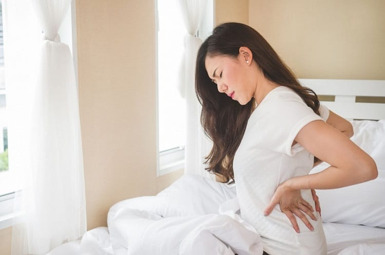 girl with morning backpain