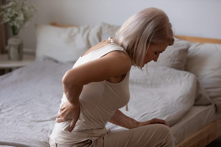 woman with backpain in the morning