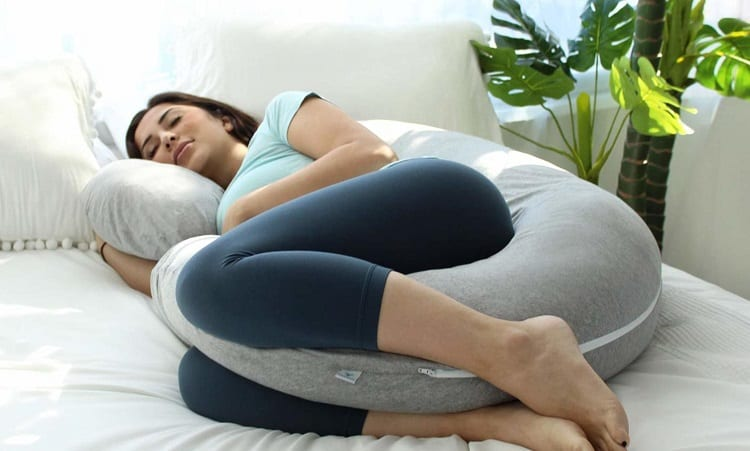 Woman Sleeping On Pregnancy Pillow