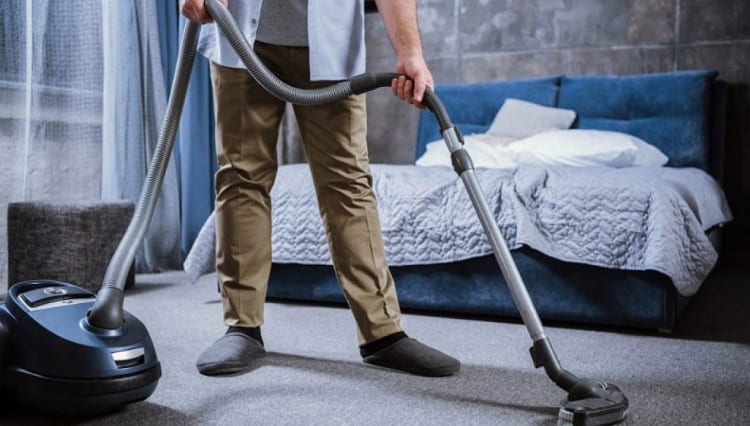 Vacuuming Bedroom