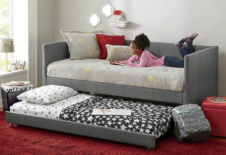 Young Girl Laying On Trundle Bed